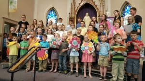 June newsletter final pic of kids singing
